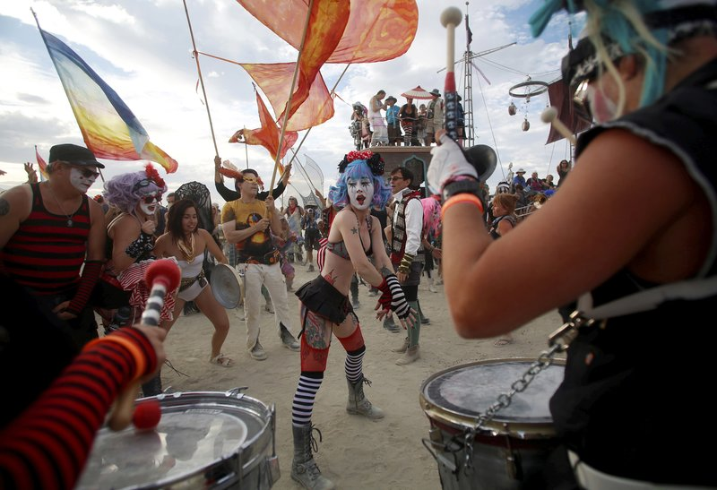 Members of the Trash Kan Marchink Band perform as approximately 70,000 people from all over the world gather for the 30th annual Burning Man arts and music festival in the Black Rock Desert of Nevada, U.S. August 29, 2016.